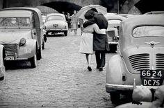Lovers at le Pont-Neuf, Paris, 1962.   by  Daniel Lebée