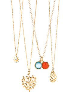 Paloma Picasso® pendants, from left: Venezia Stella pendant in 18k gold with a diamond, Olive Leaf pendant in 18k gold, milky quartz dot charm in 18k gold, carnelian dot charm in 18k gold on the Paloma Picasso® round link chain and Venezia Luce pendant in 18k gold. #TiffanyPinterest