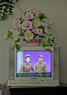 There are 2 TV channels in North Korea: one which shows archives of Kim Il Sung with presidents from last century, the other which broadcasts songs, shows, military events, old propaganda movies, all dedicated to the glory of North Korea.