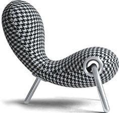 Reminiscent of Eero Saarinen's Tulip Chair (1955) and Arne Jacobsen's Swan Chair (1958), Marc Newson's Embryo Chair evokes innovative design from the 60s and 70s ...