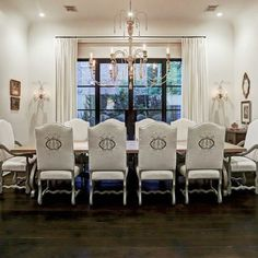 Elegant French country white dining room in a Houston mansion by Thomas O'Neill Homes. #frenchcountry #diningroom #luxuryhome #interiordesign