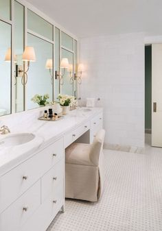 With Waterworks, the McGraths created a custom mosaic floor tile pattern combining white Thassos and polished Calacatta gold marble. The walls are covered in Thassos brick tile, with a baseboard in Calacatta gold. The fittings throughout are also by Waterworks | archdigest.com