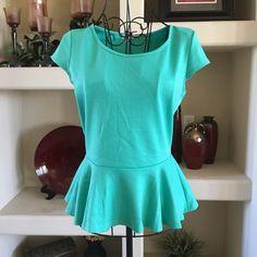 A'gaci mint green peplum top A'gaci mint green peplum top, 75% polyester 22% rayon, 3% spandex a'gaci Tops