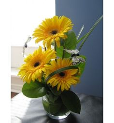 3 gorgeous gerbera daisies, lily grass and butterfly accents ;)
