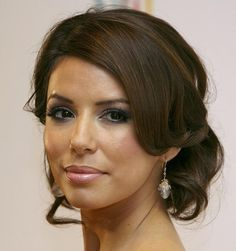 Elegant low updo hair style side-part curls Eva Longoria