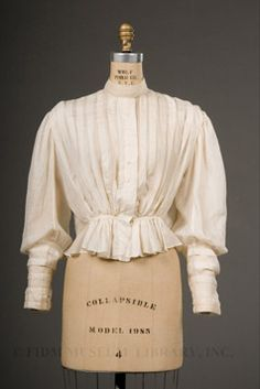 Shirtwaists. A shirtwaist was the name for a blouse with leg of mutton sleeves and a more tailored look. It was usually embroidered and had lace and frills, although it was modeled after a man's shirt.