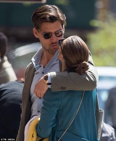 Pucker up: The socialite, 32, and her model husband, 40, shared a sweet kiss, before wandering through the streets of New York with their arms wrapped around each other