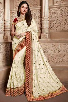 Cream silk saree with red banglori silk blouse, embellished with dori work, resham work, sequins, stone work and zari work. Saree with Round Neck, Short Sleeve. It comes with unstitch blouse, it can be stitched 32 to 58 sizes. #cream #silk #saree #blouse #Andaazfashion #UK South Silk Sarees, Indian Silk Sarees, Indian Bridal Lehenga, Art Silk Sarees, Maroon Saree, Bollywood Designer Sarees, Wedding Saree Collection, Saree Blouse Designs, Dress Designs