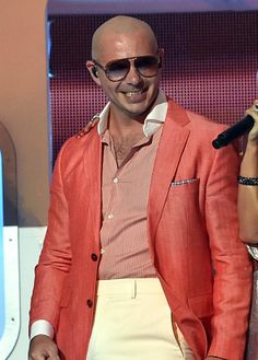 Pitbull Photos - Rapper Pitbull performs onstage during the 2014 iHeartRadio Music Awards held at The Shrine Auditorium on May 1, 2014 in Los Angeles, California. iHeartRadio Music Awards are being broadcast live on NBC. - iHeartRadio Music Awards Show
