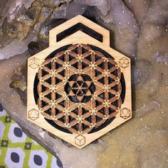 from @galacticartifacts -  Seed within the #FlowerofLife surrounded by the 5 #PlatonicSolids . One of the new designs from #GalacticArtifacts . #SeedofLife #SacredGeometry #laserengraved #wood #pendant #jewelry