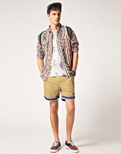 Chino shorts by ASOS. Constructed from a cotton twill. Featuring a button fly, belt loops, two side pockets, contrast striped turn up hems, two patch pockets to the reverse and a regular fit.   [$37.32]