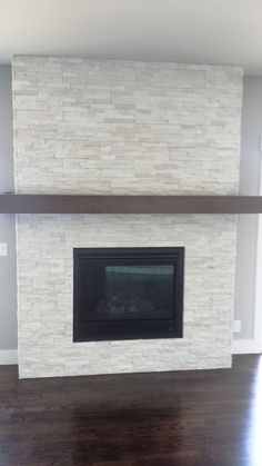 Best Traditional and Modern Fireplace Design Ideas Photos & Pictures Stone Fireplace – beautiful, modern finish Modern Fireplace Tiles, Tiled Fireplace Wall, Fireplace Redo, Fireplace Remodel, Brick Fireplace, Living Room With Fireplace, Fireplace Surrounds, Fireplace Design, Fireplace Mantels