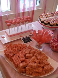 """Cute idea for a girl's birthday party: Instead of a """"white party,"""" a """"Pink Party!""""  Ideas and links for where to buy at Simple/Fancy/Fun -  girl's 1st birthday party ideas - colored rice crispy treats"""