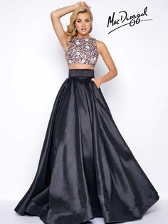 High neck, two piece, prom dress with fully beaded top and satin ball gown skirt with pockets. This trendy prom dress comes in both Black/Multi and Royal/Multi.
