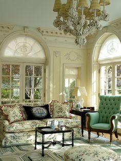 Such beautiful walls, fuchsia fabric & chandelier shades!