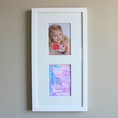 Show off your kids' artwork with their photo, like this idea from Design Improvised.