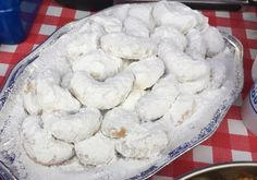 Greek cookies with a delicious toasted almond crunch and coated in lots of icing sugar.