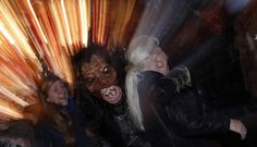 A man dressed as Krampus takes part in a parade at Munich's Christmas market on December 14, 2014. Young single men will wear the traditional attires known as 'Krampus,' consisting of animal skins and masks, with large cow-bells to make loud and frightening noises and parade through the city. They follow 'Saint Nicholas' from house to house in December each year to bring luck to the good and punish the idle.