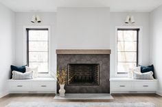 great room with white walls and two windows with window seats and pillows. stone fireplace with brick interior in the center wall. Cabinet Paint Colors, Door Paint Colors, Tile Fireplace, Farmhouse Fireplace, Brick Interior, Room Interior Design, Great Rooms, Alcove Seating, Home Living Room