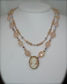 JUST PEACHY...    The focal point of this necklace is a beautiful vintage cameo pin, which Ive left intact by wire wrapping a bail onto the pin