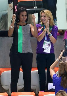 Michelle Obama & Summer Sanders watch an aquatic event
