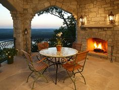 outdoor room with stone walls and fireplace