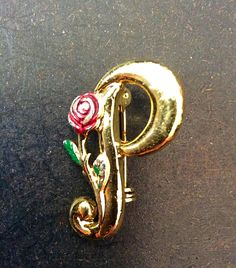 A personal favorite from my Etsy shop https://www.etsy.com/listing/233301723/gold-p-with-red-rose-brooch