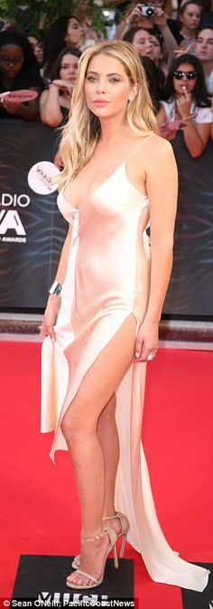 Blonde beauty: Ashley Benson was glamorous in a simple satin gown and nude heels...