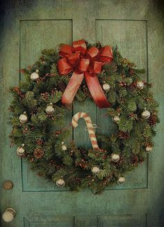 Jingle bell wreath. Minus the cane and switch for a burlap red stripe bow!