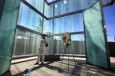 Ken Terrell from Cambridge, Mass. paused to read the names at the Logan Airport 9/11 Memorial of those killed on planes that left Boston on Sept. 11, 2001. (John Tlumacki/The Boston Globe)