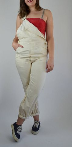 The most perfect pair of Lee overalls! Vintage 1970s oversized fit for women, Mens Large. Done in a light tan/ cream colored denim cotton. Thick gold hardware. Pockets and loops! Adjustable straps. Rolled bottom hem. Worn in to perfection!  SIZE: Large. LABEL: - BRAND: Lee Very Good Vintage Condition: There are a few flaws, but these make the overalls that much more perfect. Small little tear on the back of the right near pocket. Some random dirt/oil? discolorations near hem and on ...