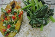 Love the heat of chili. Rice top with fish and vegie