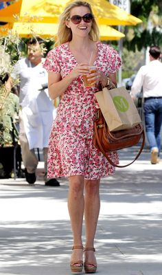 Reese Witherspoon in LA wearing pink floral dress and sandals ...