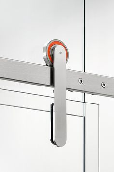 Sometimes glass installations need to pop with a little personality. Show yours in orange, black or white with Oden sliding door hardware.