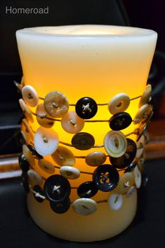 homeroad: Vintage Button Garland  You can make this by getting a few strings, buttons, and a nice candle. All you do is put the strings though the buttons. Then you tie it and put it around the candle. It is so easy!! TRY IT