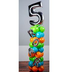 Your party guests will ROAR at the sight of our Dinosaur Balloon Column. This balloon kit includes orange, Bermuda blue and lime green latex balloons, a mylar number balloon and more. 1st Birthday Balloons, Dinosaur Birthday Party, 3rd Birthday Parties, Birthday Party Decorations, 4th Birthday, Themed Parties, Balloons And More, Number Balloons, Mylar Balloons