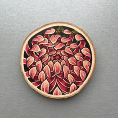 Wood slice with an original drawing / illustration of a chrysanthemum.  Can be hung on a wall or put on a shelf as decoration.  Done with acrylic marker and copic markers.  The wood slice is about 9x1,5 cm.  Only one available.  If you want to buy multiple items please contact me so i can adjust shipping costs.