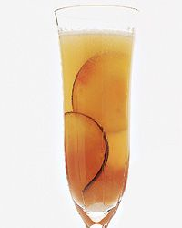 Mirabelle  Fill a pint glass with ice. Add the Plum Puree, Pernod and Champagne and stir gently. Strain into a chilled flute and garnish with the plum slices.