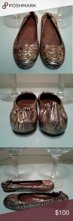 Tory Burch Reva flats Beautiful black & gold design in excellent condition LIKE NEW NO scrapes, scuffs a little snug on me i need larger size Tory Burch Shoes Flats & Loafers