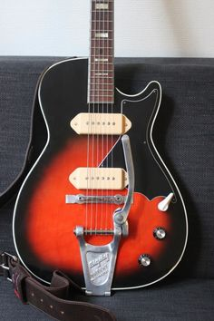 Dan Auerbach's Harmony Stratotone H47, loaded with P-90s, a Bigsby, and a compensated metal bridge. I also like that strap...