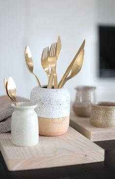 Gold cutlery, handmade vase