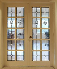 Create private spaces in your home while still making it seem open and inviting with interior stained glass doors.