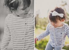Toddler girl in stripes and pearls out in the woods. Love.