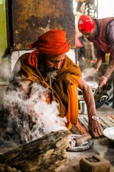 An Indian man makes chapati bread in his home in Haridwar, India