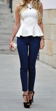 white peplum top with dark blue skinny jeans & heels