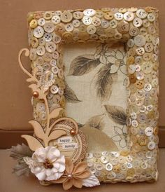 made with a foam frame, fabric, embellishments and LOTS of pinned on buttons