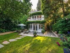 "Jennifer Lawrence The ""Hunger Games"" star recently nabbed this Beverly Hills property from songstress Jessica Simpson. The cobblestoned courtyard along with trained ivy channel the English countryside.   Photo: House Beautiful/Racked"
