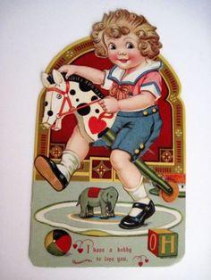 CHILD ON HOBBY HORSE
