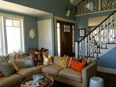 like color of walls and color palette. Fun pillows and I love those stairs!!