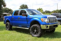 blue ford F-150 Ford lifted truck